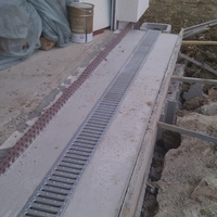 Trench drain installation in a concrete base
